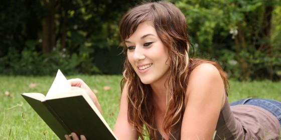 o-SMILING-READING-BOOK-facebook